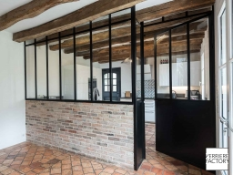 Maison Chevalier : Porte d'atelier acier